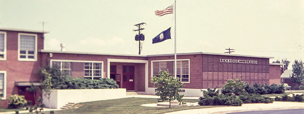 Color photograph of the main entrance of Lynbrook Elementary School from a 35 millimeter slide, taken in the late 1970s or early 1980s.