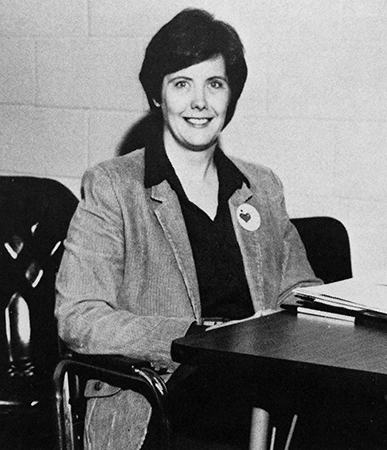 Black and white portrait of Principal Bealor taken in 1982. She is seated at a table.