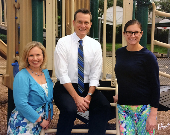 Color portrait of Principal Nocco and two Lynbrook assistant principals taken in 2018. They are posed outside on playground equipment.