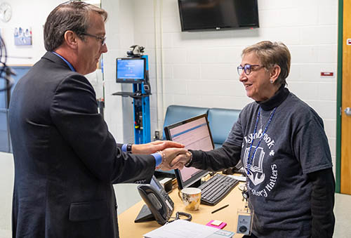 photo of parent liaison shaking hands with superintendent